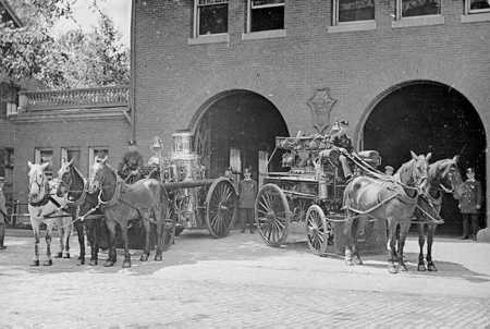 Engine 2's pump and wagon in front of quarters, circa 1894. The steam pump was an 1873 Amoskeag 700 gpm. The hose wagon was an 1892 Abbot and Sowning.