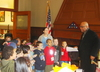 4 of 6: The 1st grade students gather around Mayor Reeves as he thanks them for their visit and gifts.