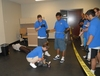 9 of 11: Youth Police Academy participants investigate a mock crime scene.