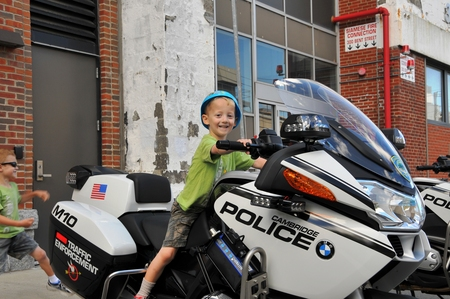 Enjoying a ride on a Cambridge Police motorcycle.