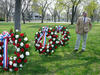 1 of 24: Veterans' Services Deputy Director Steve Vesce with the Patriots' Day wreaths.