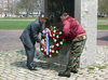 9 of 24: Cambridge Department of Veterans' Services Director Bob Stevens (L) places a wreath at the Washington Monument.